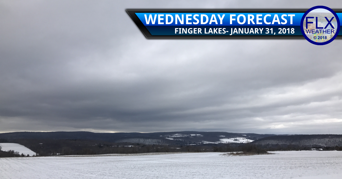 Warmer air pushes north, brings a few flurries Wednesday